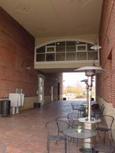 covered paved walkway w/sidewalk cafe